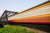 Trains Run Through The Bridge With Speed Blur.