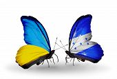 Two Butterflies With Flags On Wings As Symbol Of Relations Ukraine And Honduras