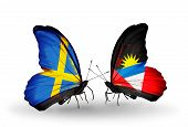 Two Butterflies With Flags On Wings As Symbol Of Relations Sweden And Antigua And Barbuda
