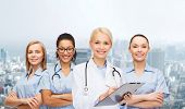 healthcare and medicine concept - smiling female doctor and nurses with stethoscope