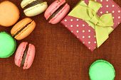 Traditional french colorful macaroons with gift box and copy-space