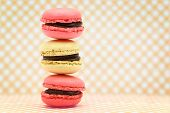 Traditional french colorful macaroons on retro background