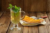 Mint Tea And Toasts With Orange Marmalade On Wooden Background