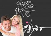 Handsome man giving piggy back to his girlfriend against cute valentines message