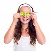 Girl With Kiwi Slices Over Her Eyes