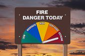 Extreme fire danger today sign with orange sunrise.