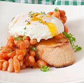 Breakfast - poached egg with toast, baked beans with tomato sauce