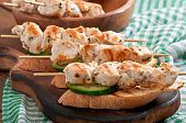 image of kebab  - Chicken kebabs on skewers with toast and cucumber - JPG