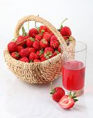 Fresh Ripe Strawberry In A Wattled Basket And A Glass Of Strawberry Juice