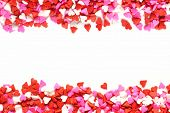 stock photo of sprinkling  - Valentines Day candy heart double edge border of red - JPG