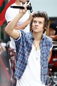 NEW YORK-AUG 23: Harry Styles of One Direction performs on NBC's 'Today Show' at Rockefeller Plaza on  August 23, 2013 in New York City.