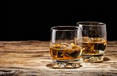 pic of whiskey  - Whiskey drinks on wooden table with black background - JPG