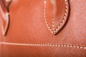 picture of stitches  - Brown Stitched Macro Detail Of Woman Handbag  - JPG