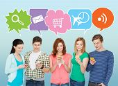 people, communication and technology concept - smiling friends with smartphones over blue background with doodles