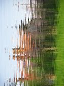 stock photo of shivering  - abstract shapes of objects reflecting in the water - JPG