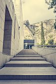 stock photo of staircases  - Marble staircase leading into glass entrance with mountain in the background - JPG