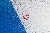 Heart Through Water Drops On Glass