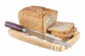 Cut Wholemeal Bread And Knife On A Chopping Board