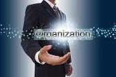 Businessman hand showing organization button .