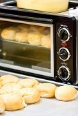 Baked Bun In Front Of Microwave Oven.
