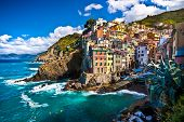 stock photo of cliffs  - Riomaggiore fisherman village in a dramatic windy weather - JPG