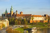 KRAKOW, POLAND - OCT 20, 2013: View of Royal Wawel castle and Vistula River. The monument to the history of the Decree of the President Lech Walesa on Sep 8, 1994.