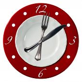 foto of compose  - Clock composed by a white plate and a red underplate with fork and knife in the place of the clock hands - JPG