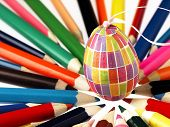 Colorful Wooden Crayons And Easter Egg.