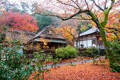 KYOTO, JAPAN - DECEMBER 1, 2014: Tourists visit the Hogonin Temple. This temple and landscaped gardens are reminiscent of the eighth century period Japan and is a major tourist attraction in Kyoto.