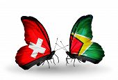 Two Butterflies With Flags On Wings As Symbol Of Relations Switzerland And Guyana