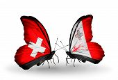 Two Butterflies With Flags On Wings As Symbol Of Relations Switzerland And Malta