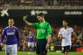 VALENCIA, SPAIN - JANUARY 4: Referee (Center) during Spanish King Cup match between Valencia CF and RCD Espanyol at Mestalla Stadium on January 4, 2015 in Valencia, Spain