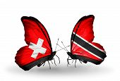 Two Butterflies With Flags On Wings As Symbol Of Relations Switzerland And Trinidad And Tobago