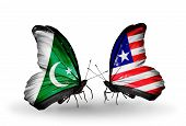 Two Butterflies With Flags On Wings As Symbol Of Relations Pakistan And Liberia