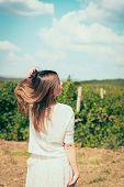 Woman  Walks On A Vineyard