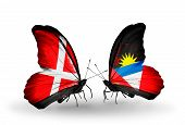 Two Butterflies With Flags On Wings As Symbol Of Relations Denmark And Antigua And Barbuda
