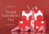 Happy Valentines Day Stack Of Red And White Gifts On Red Background With Sample Text Greeting Messag