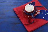 Happy Australia Day, January 26, Theme Table Setting With Red, White And Blue Cupcake On Red Polka D