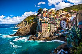 image of suspenders  - Riomaggiore fisherman village in a dramatic windy weather - JPG
