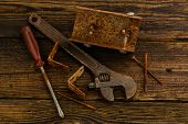 stock photo of braces  - corner braces screws screwdriver and adjustable wrench on wooden background - JPG