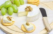 image of brie cheese  - Soft brie cheese with crackers and nuts closeup - JPG