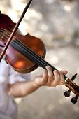 stock photo of orchestra  - Hand of a violinist playing in a classic orchestra - JPG