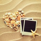 pic of beach shell art  - Summer like old style empty photo cards lying on a sea sand and framed with shells. Sunny summer background. Space for your text.  - JPG