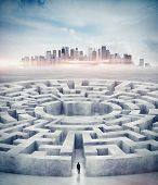 stock photo of maze  - Business man and a huge concrete maze - JPG