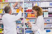 picture of prescription  - Pharmacists searching medicines with prescription at hospital pharmacy - JPG