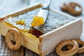 picture of bagel  - Honey comb and small bagels on a wooden table - JPG