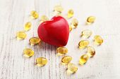 foto of cod  - Red heart and cod liver oil - JPG