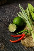 image of lime  - chili pepper with lime and Kaffir lime leaf on old wooden table Thai style cooking ingredient - JPG