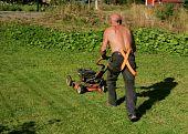 Senior mowing a lawn