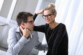 pic of office romance  - happy smiling young couple in the office - JPG